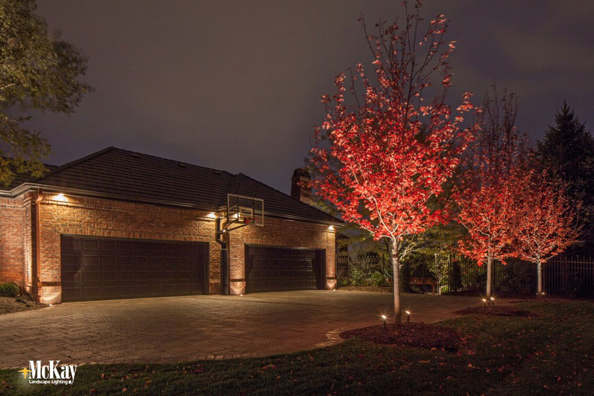 See How to Boost Nighttime Garage Curb Appeal Omaha, Nebraska - McKay Landscape Lighting