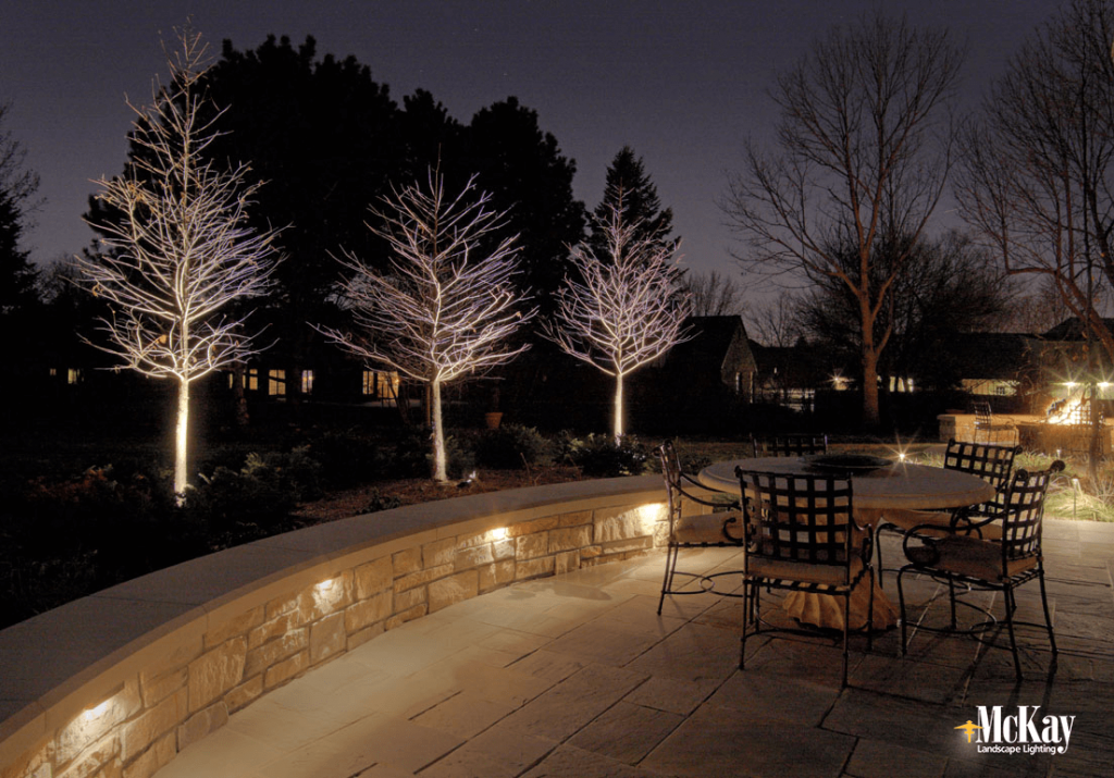 Patio Seat Wall Lighting: a beautiful application ideal for patios, free-standing features, or steps. Click to see more deck & patio lighting ideas... McKay Landscape Lighting - Omaha, Nebraska