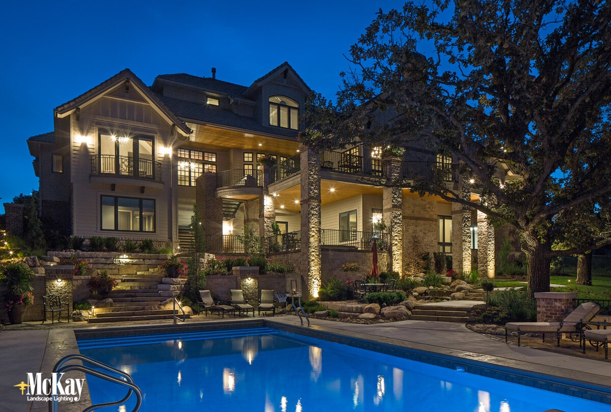 Outdoor lighting provides a unique ambiance and makes hazardous areas like steps, walkways, and pool edges safer | McKay Landscape Lighting, Omaha Nebraska