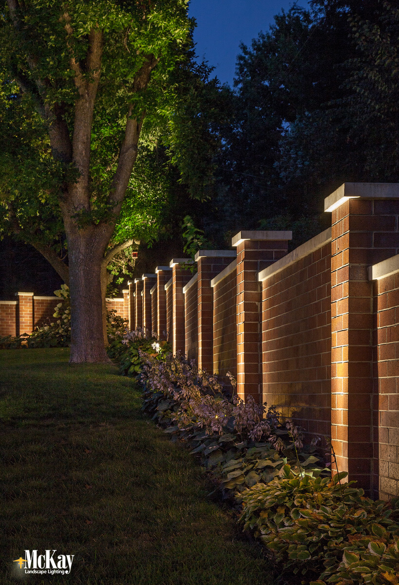 Outdoor wall lighting can help make your backyard safer while providing a stronger sense of security. Click to learn more about how lighting a few prominent areas can increase security and beauty... | McKay Landscape Lighting Omaha Nebraska