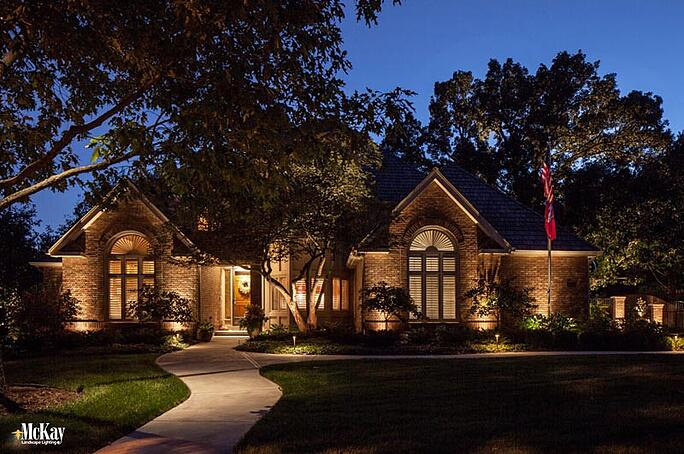 Landscape lighting makes the American flag a strong focal point at night adding interest and color. Click to read more about flag lighting requirements & tips | McKay Landscape Lighting Omaha Nebraska