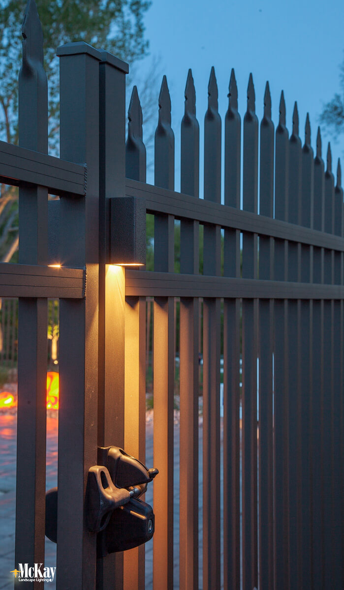 Installing an outdoor gate light directly above the entrance will provide ample light to the gate latch and the surrounding area. Opening your gate at night will be considerably easier while providing a safer way to enter your backyard.  Click to learn more... | McKay Landscape Lighting - Omaha Nebraska