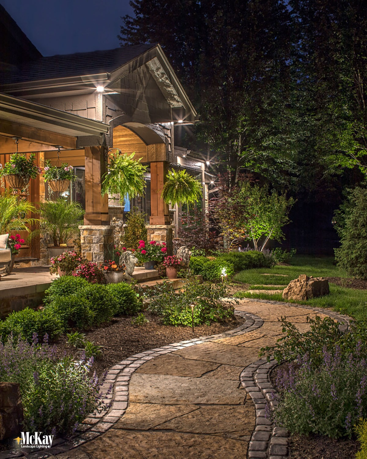 The key to using path lights is finding the perfect balance for your walkway. Too many lights will give a runway type of look while too few lights will leave dark spots. Learn more about path lighting... | McKay Landscape Lighting Omaha Nebraska