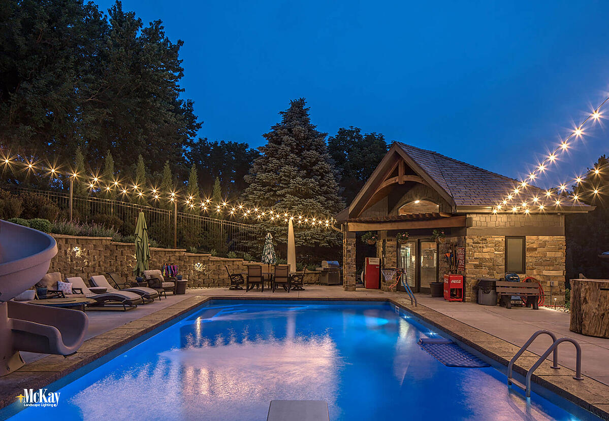 Outdoor Bistro String Lighting Around The Pool - Outdoor Lighting Pool Deck with String Lights Omaha Nebraska McKay Landscape Lighting