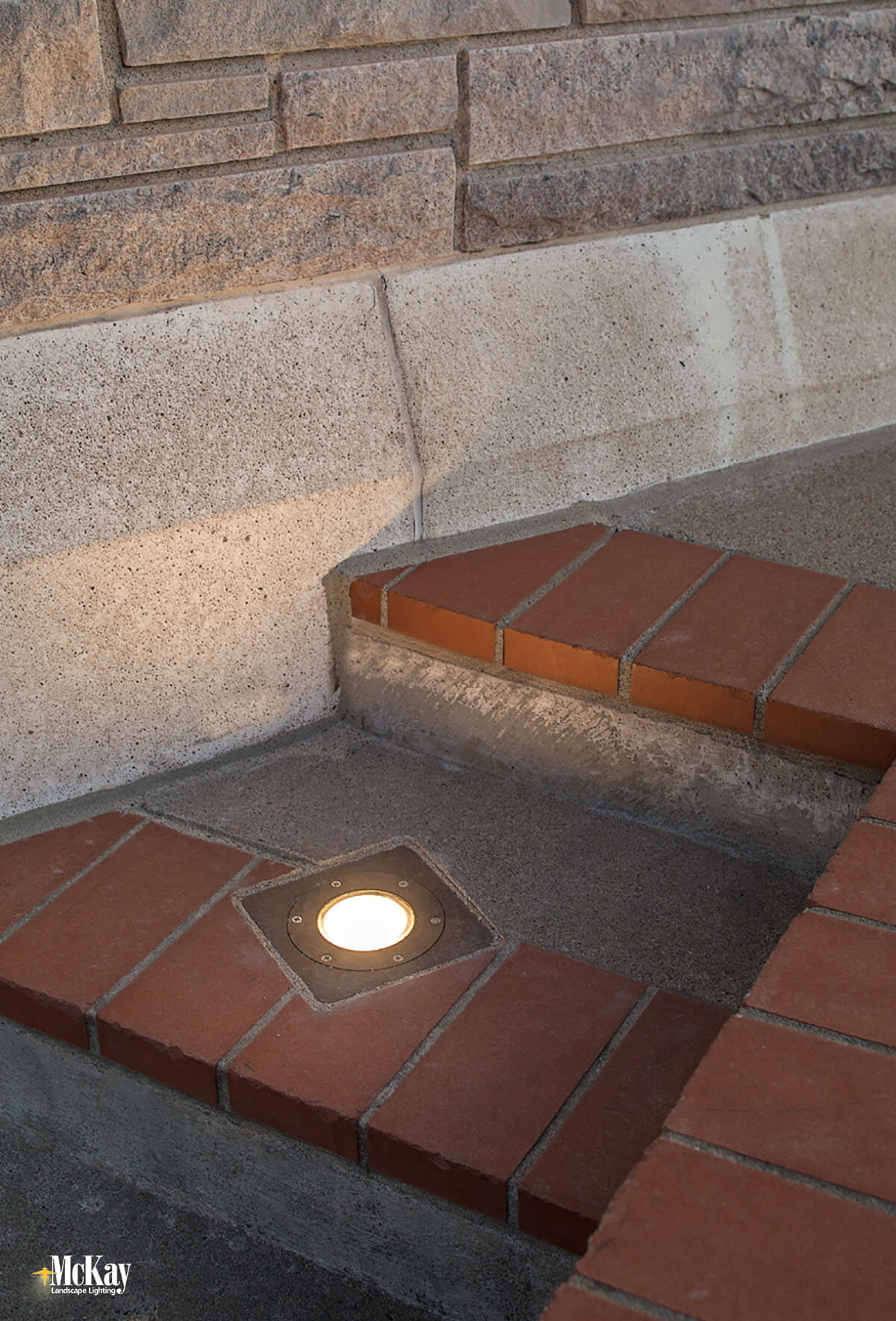 The building is surrounded by concrete which can sometimes make installing well lights difficult. Click to learn more about the commercial landscape lighting design... | McKay Lighting - Omaha, Nebraska