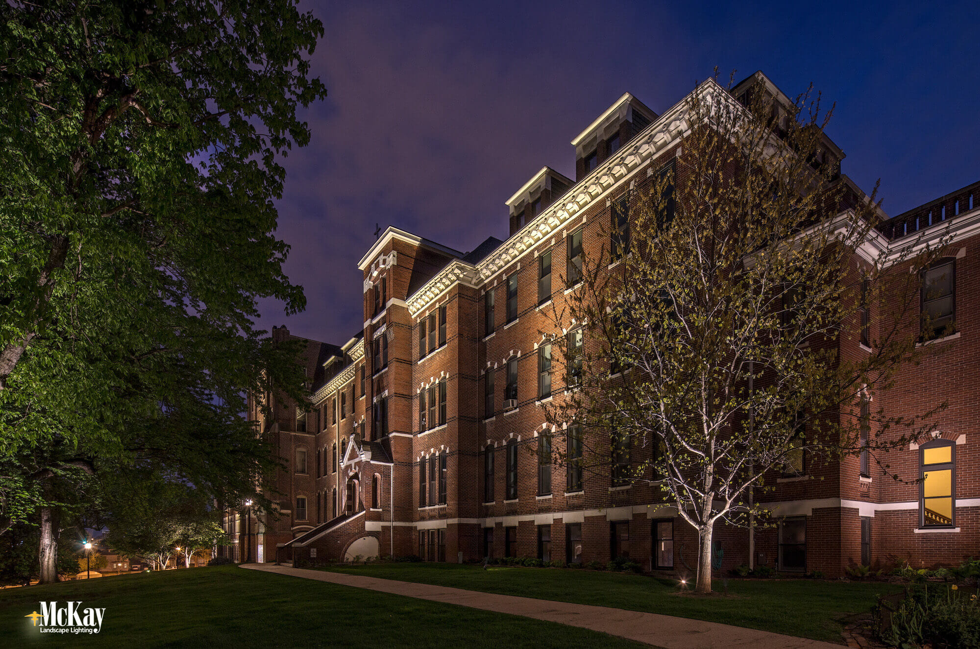 The exterior lighting improvements helped the school lower its overall energy consumption. Learn more about the commercial outdoor lighting design... | McKay Landscape Lighting Omaha Nebraska