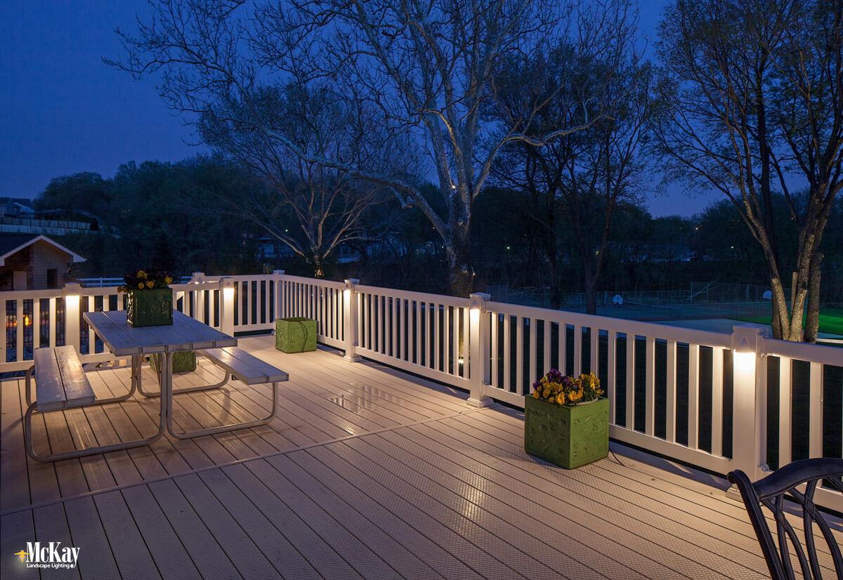 Deck lighting fixtures can be used on deck railings, posts, and stairs. Adding light to the posts of your deck can easily extend the time spent outside while adding safety. Click to learn more... | McKay Landscape Lighting Omaha Nebraska