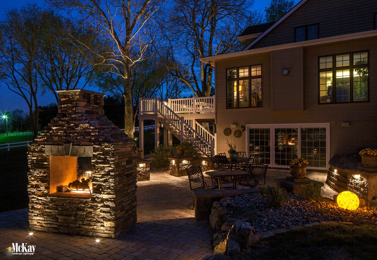 For fireplaces made out of stone or brick, uplighting provides a unique shadowing effect. The light trickles up the stone or brick, drawing attention to all the intricate details of the hardscape. Click to read more   McKay Landscape Lighting - Omaha, Nebraska