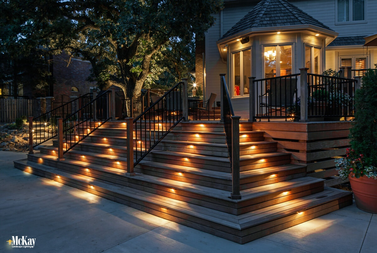 If you entertain or spend time outside after dark, then lighting your walkways, paths, steps, and stairs will decrease the chance you, a family member, or a guest will trip or fall. Click to learn more about the benefits of outdoor lighting... | McKay Landscape Lighting Omaha Nebraska