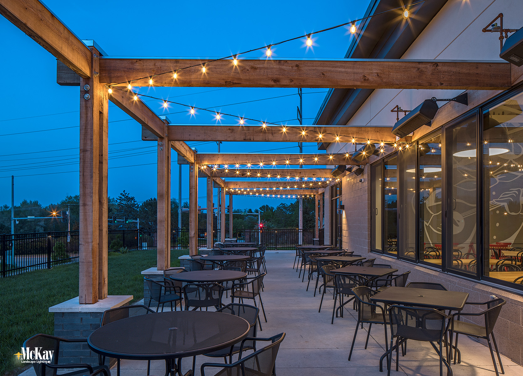 Outdoor String Lights Enhance Restaurant Patio Ambiance Omaha Nebraska | McKay Landscape Lighting