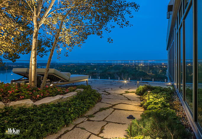 See more photos of the landscape lighting design for this relaxing rooftop garden patio located in Downtown Omaha. | Outdoor lighting design installed by McKay Landscape Lighting in Omaha, Nebraska