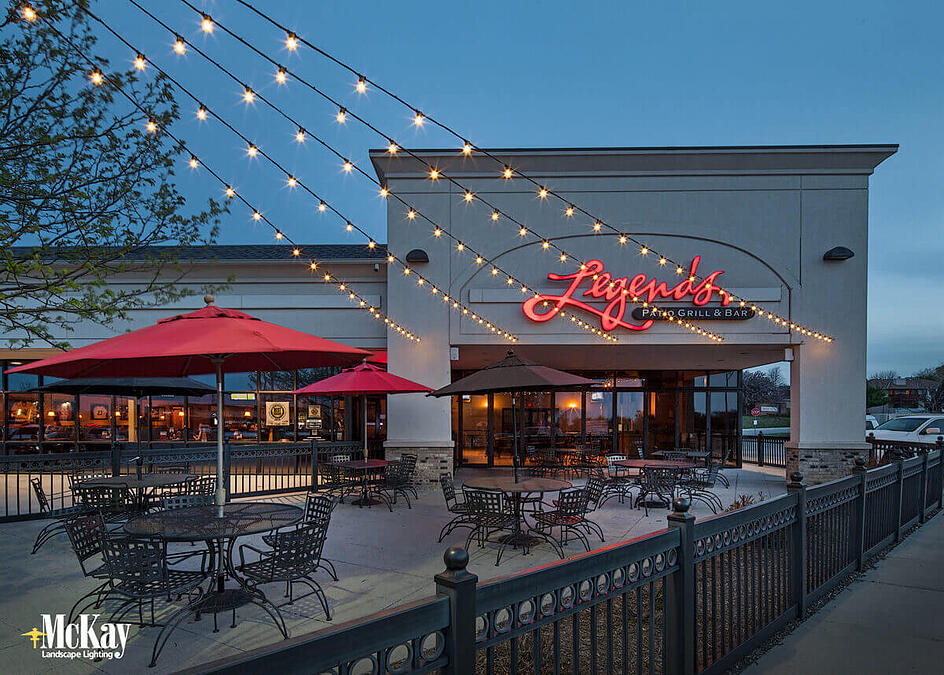 Outdoor string lights bring a casual attitude to outdoor dining and are a popular restaurant patio lighting option for a variety of reasons. Click to read more... | McKay Landscape Lighting Omaha Nebraska