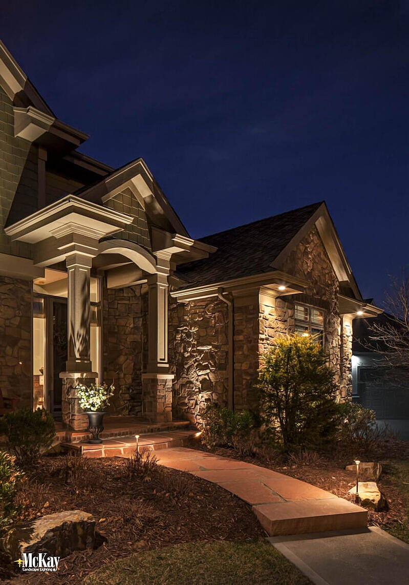 The key to using path lights is finding the perfect balance for your walkway. Too many lights will give a runway type of look while too few lights will leave dark spots. Learn more about path lighting...   McKay Landscape Lighting Omaha Nebraska