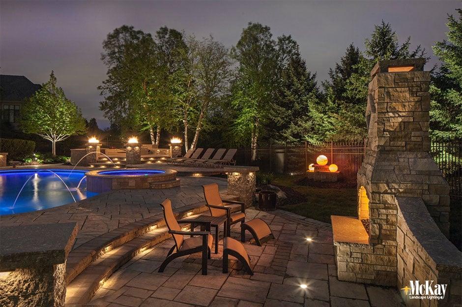 landscape lighting outdoor stone fireplace omaha nebraska