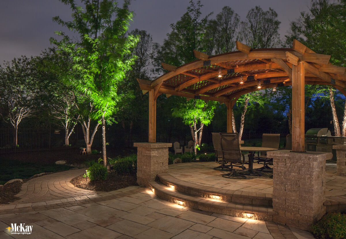Seat wall lights in outdoor stone stairs Omaha Nebraska | McKay Landscape Lighting
