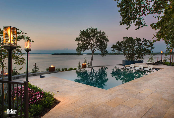 The landscape lighting design adds to the aesthetics of this lakefront estate while increasing the safety throughout. Click to find out more... | McKay Landscape Lighting, Omaha, Nebraska
