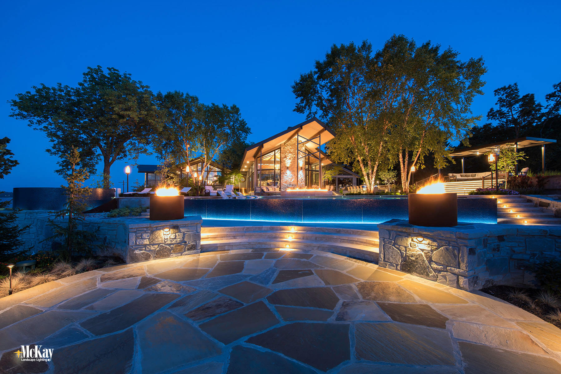 A control system was used to create separate light scene selections that allow the homeowner to easily adjust the outdoor lighting depending on what they are doing or the event function with their phone or tablet. Click to learn more lighting this outdoor space... | McKay Landscape Lighting, Omaha, Nebraska