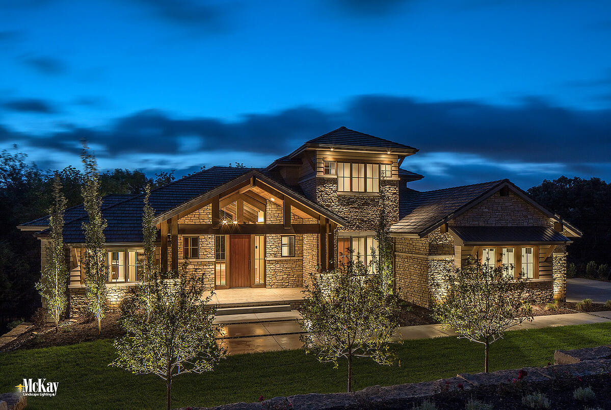 Strategically placed outdoor lighting can enhance the nighttime beauty of a home by highlighting its distinct features while increasing security, and transforming your outdoor areas.  Click to learn more about the top benefits outdoor lighting brings to a home. | McKay Landscape Lighting Omaha Nebraska