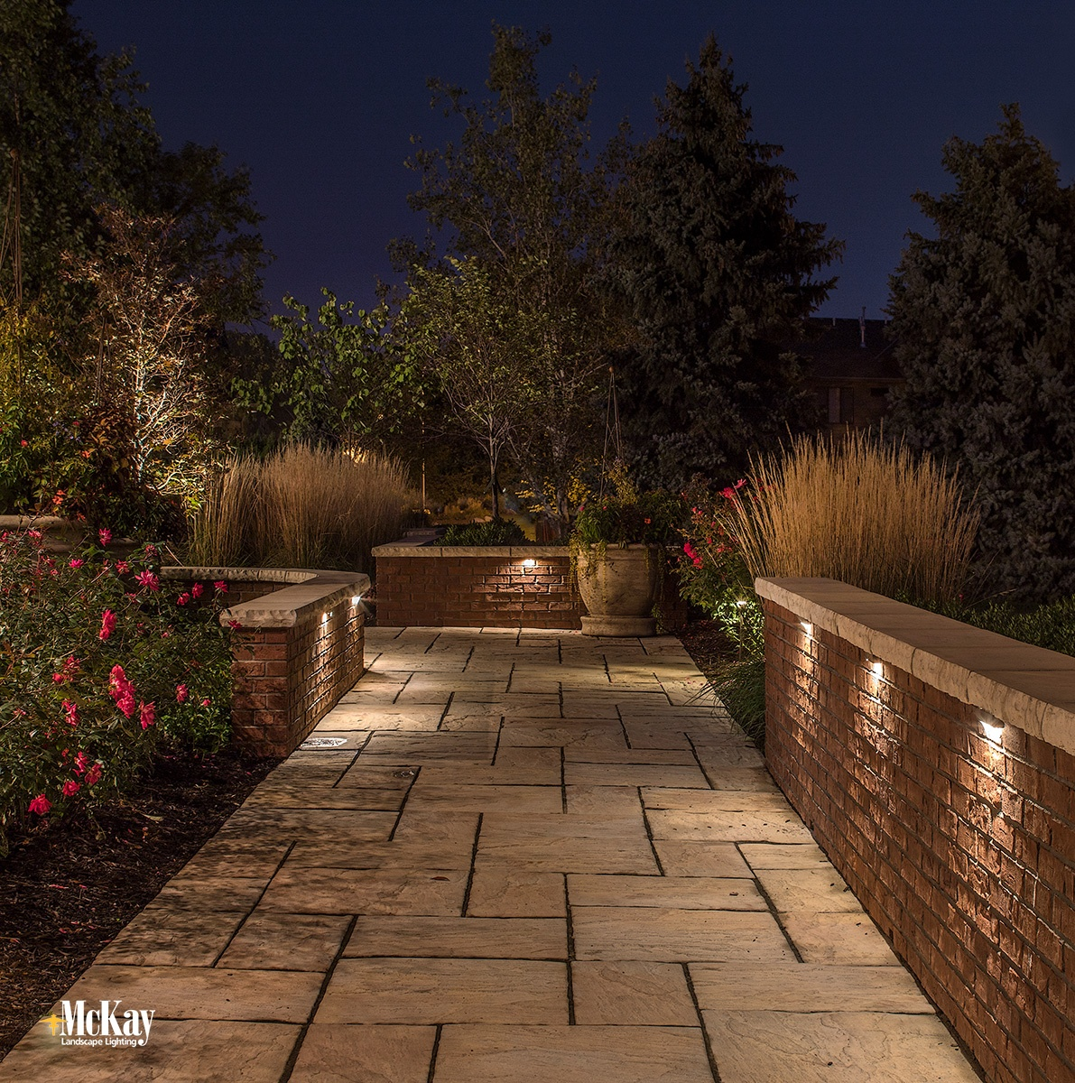 If the path leading to your home has a wall or similar structure, wall lighting is a unique way to illuminate it.  Click to read more about wall lighting... | McKay Lighting Omaha Nebraska
