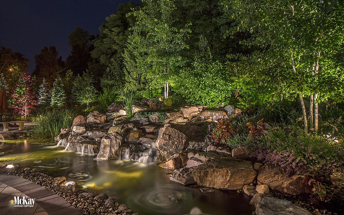 Outdoor Lighting Pond Rock Water Feature - Backyard Outdoor Lighting Design Ideas Omaha Nebraska McKay Landscape Lighting