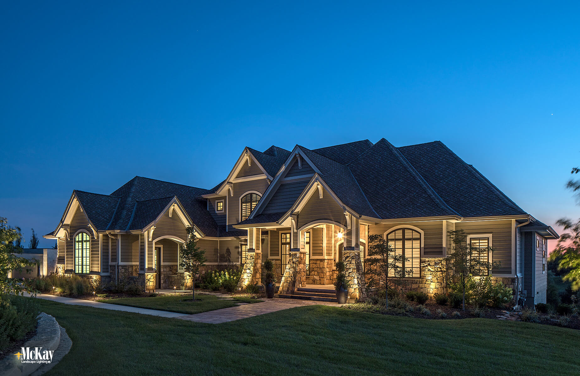"""""""We live in a remote area with very little light at night so adding landscape lighting really made a huge difference for us,"""" the homeowner said. """"It makes our home more welcoming and it just looks so beautiful when we come home in the evening..."""" Click to learn more 