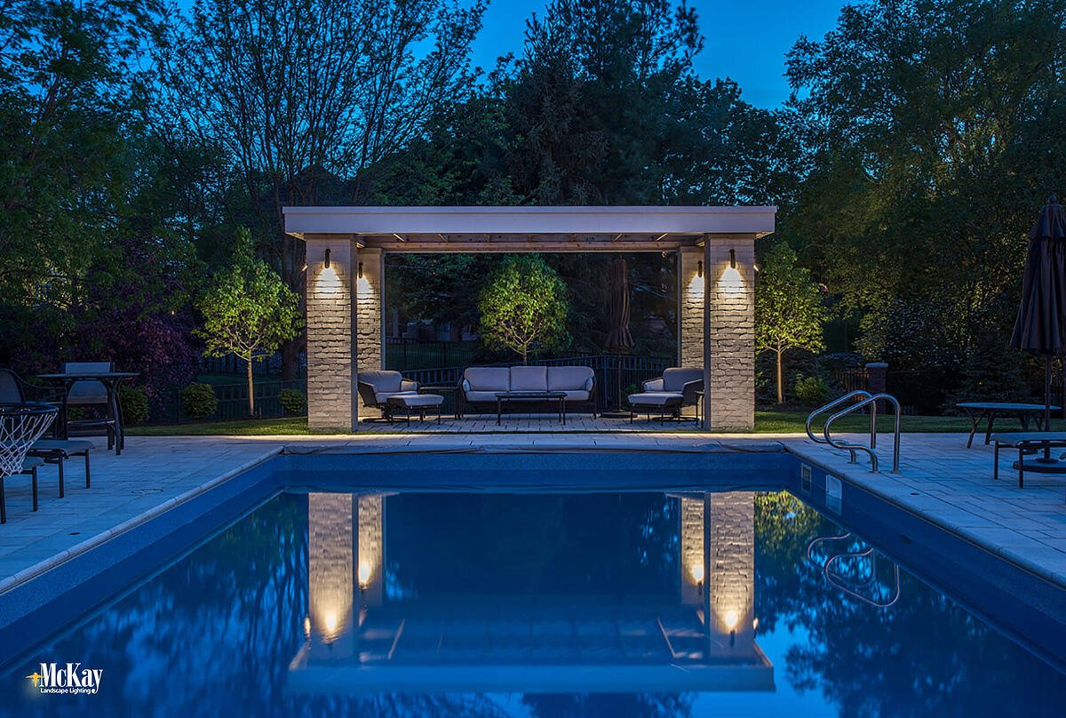 There are multiple ways to light a pergola. The best application for this pergola was to light from above. The light provides extra illumination for safely walking around the pool, and the reflection of the pool adds an element of interest. Click to read more... | McKay Landscape Lighting - Omaha, Nebraska