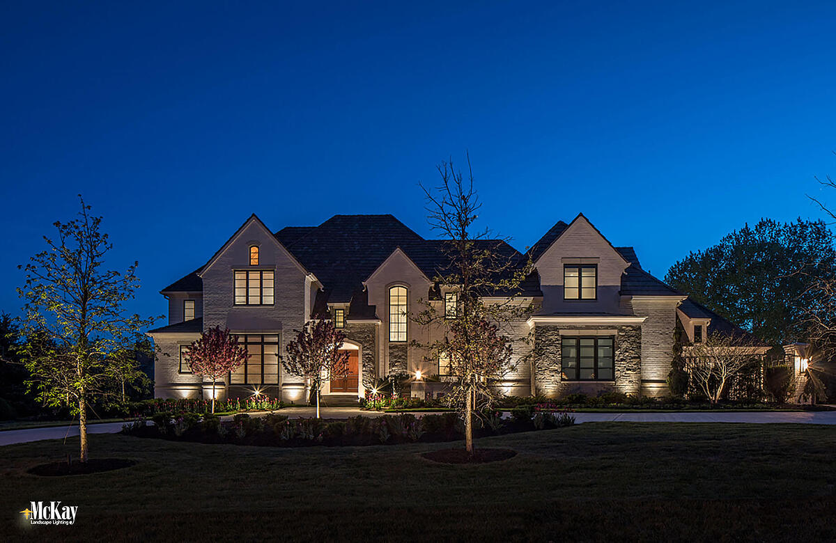 This landscape lighting design enhances the home's timeless beauty while adding a layer of security, which was important for the homeowners. Click to read more... | McKay Landscape Lighting - Omaha, Nebraska