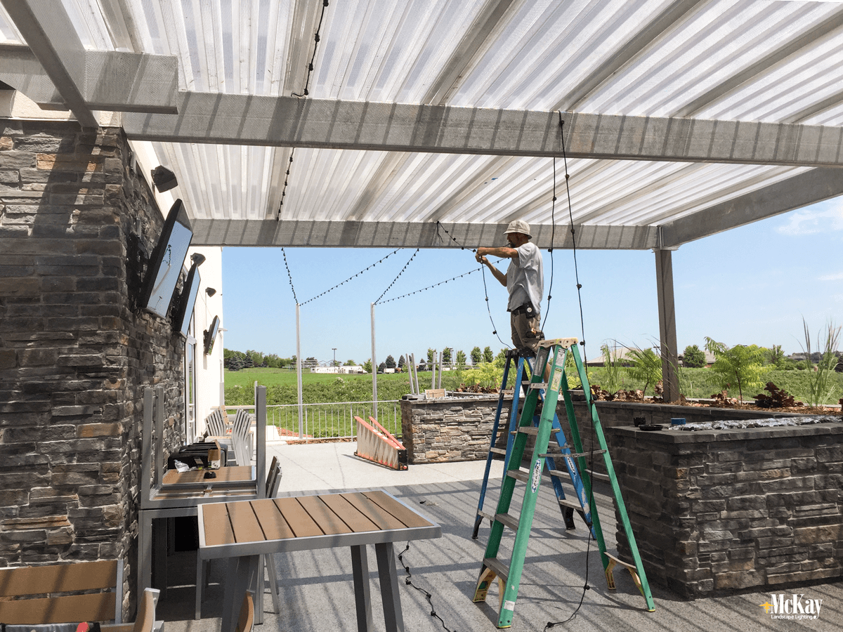Outdoor string lights offer versatility on how your space is used. With the entire space properly illuminated from above, you have endless choices when configuring tables for different event functions or group sizes. Click to read more... | McKay Landscape Lighting Omaha Nebraska