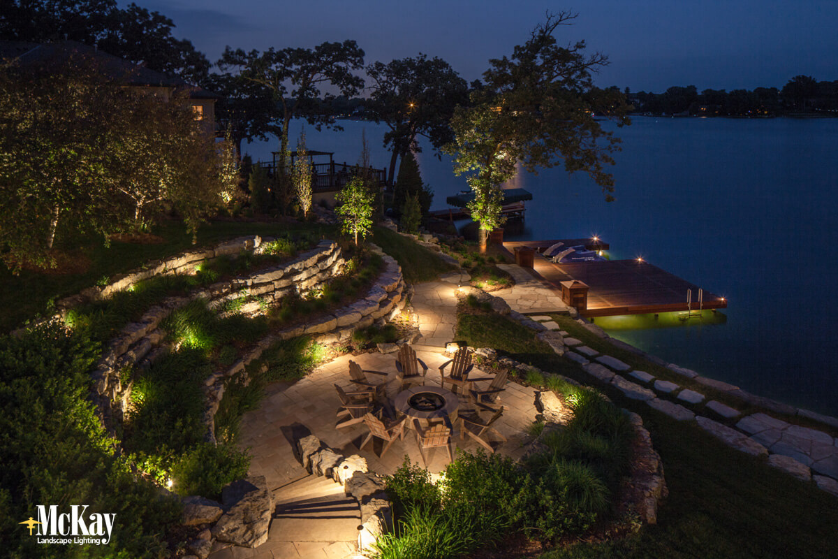Spend more time utilizing your outdoor spaces at your lake home retreat with expertly designed and installed landscape lighting. See more lake home lighting ideas... | McKay Landscape Lighting - Omaha, Nebraska