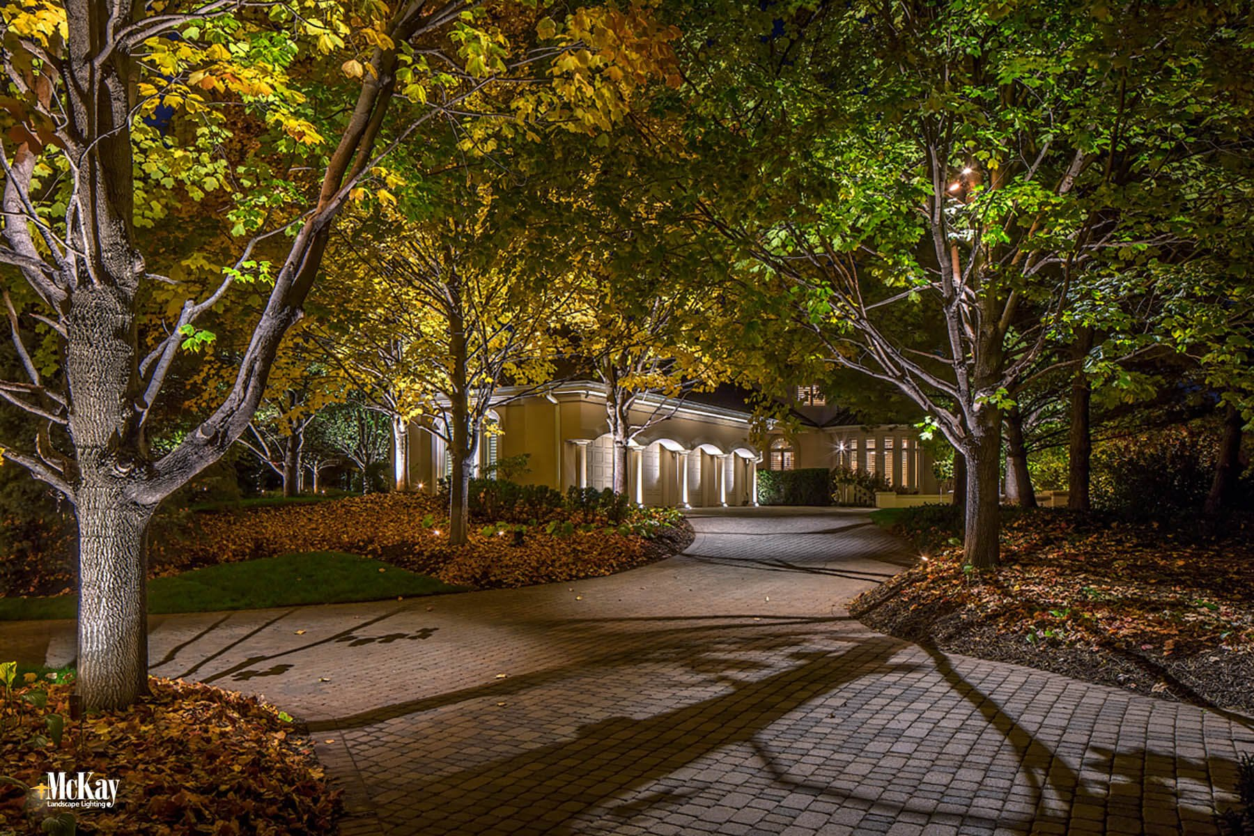 Jerry McKay of McKay Landscape Lighting gave the homeowners a fresh new design that enhances the home's beauty and increases curb appeal. Click to learn more... | Driveway Lighting Omaha Nebraska