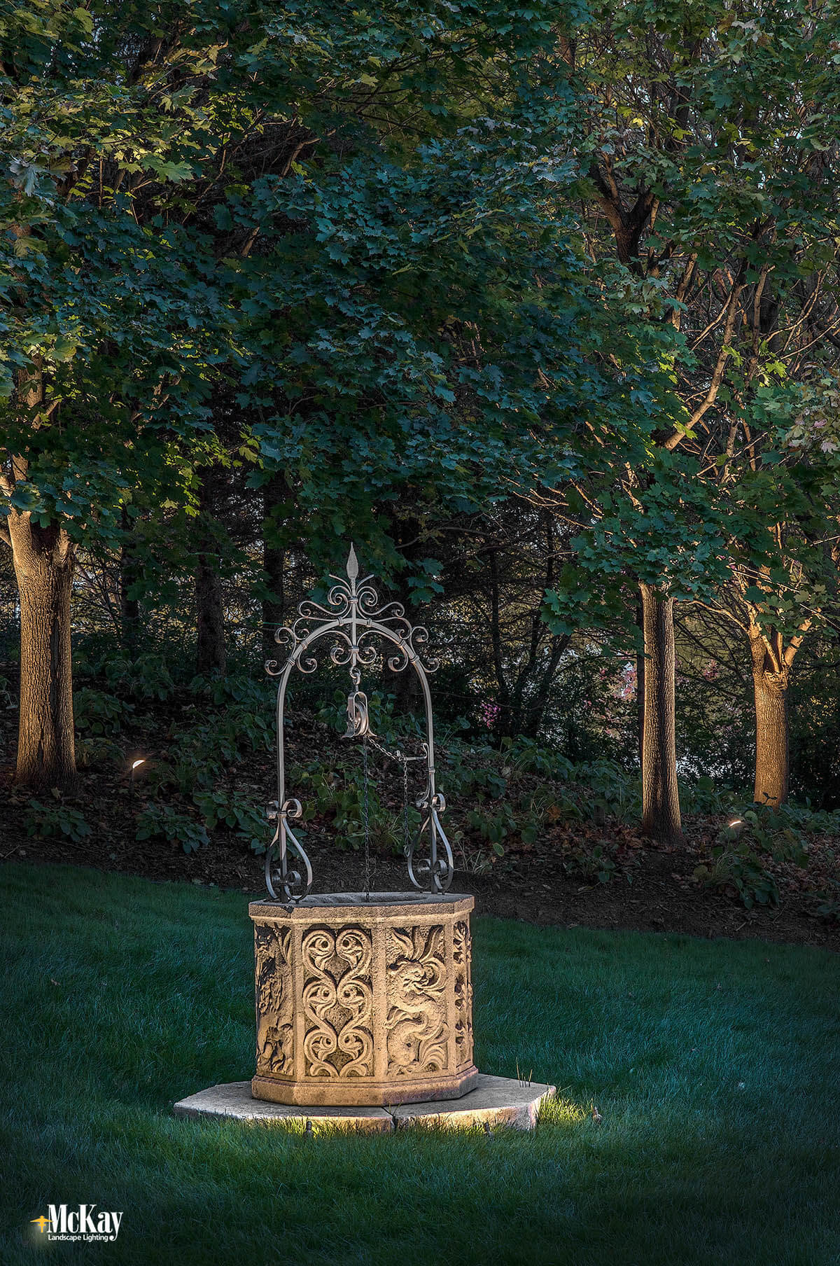 The new landscape lighting design completely transformed the property, adding curb appeal and interest. Click to see more photos of the lighting design... | McKay Landscape Lighting - Omaha, Nebraska