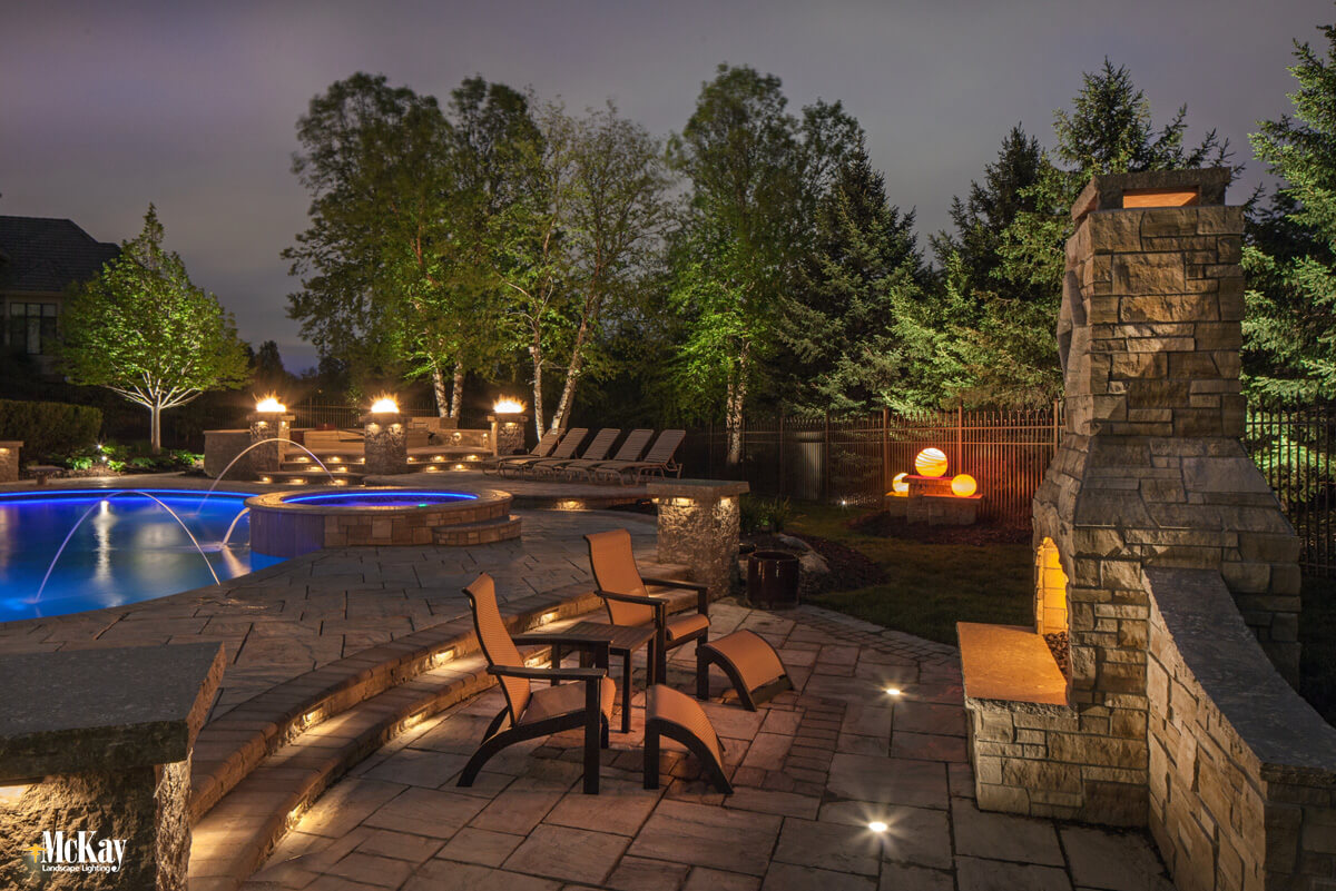 Draw attention to all the intricate hardscaping details of your outdoor fireplace lighting. Click to learn more and see more ideas...   McKay Landscape Lighting - Omaha Nebraska