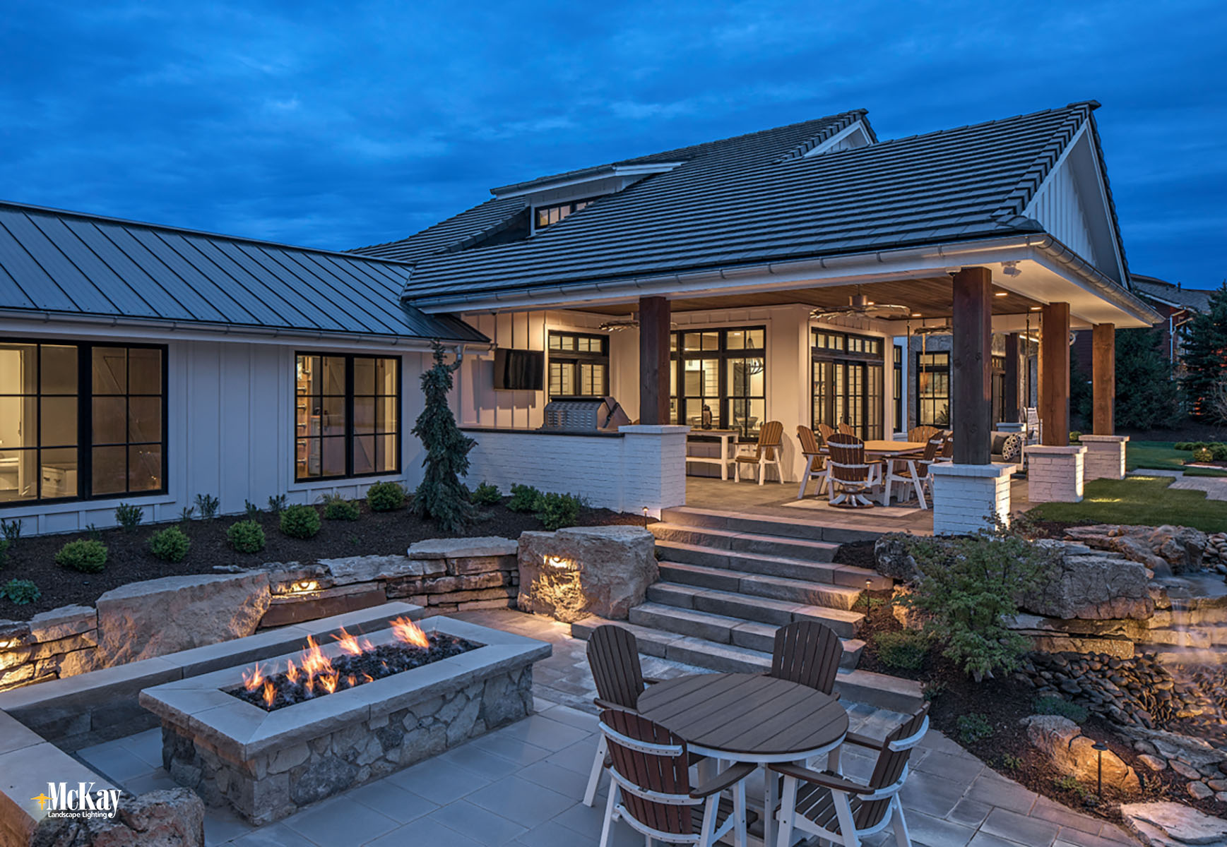 Lake House Outdoor Patio Lighting around Fire Pit Bluewater Lake Valley Nebraska McKay Landscape Lighting