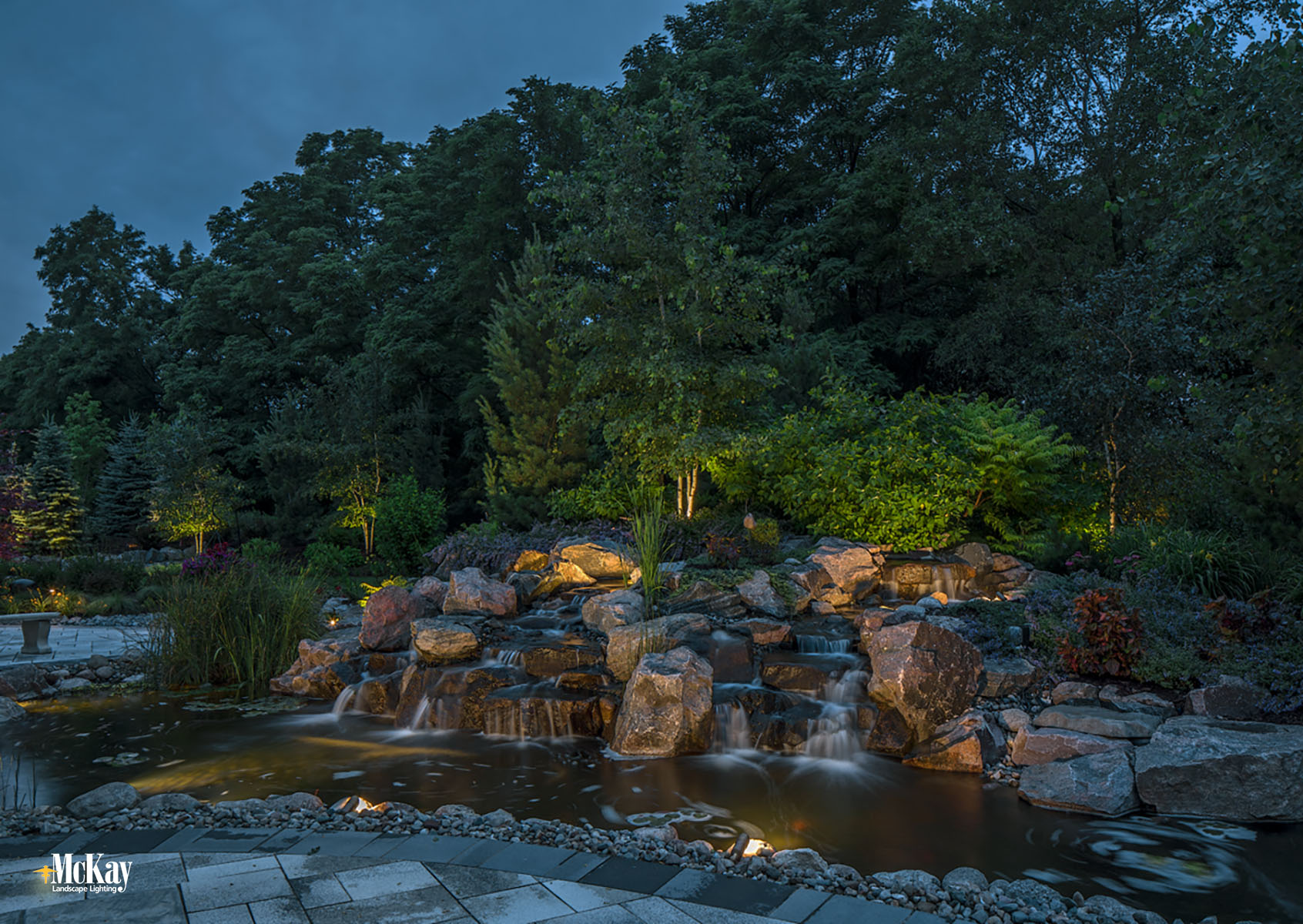 Landscape Lighting Design - Outdoor Pond Waterfall Elkhorn Nebraska | McKay Landscape Lighting